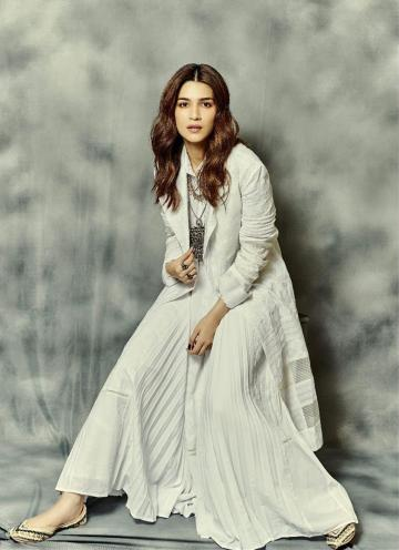 The coat, flowy top and flared palazzo are all in white self-work linen, a cool option - Fashion Models