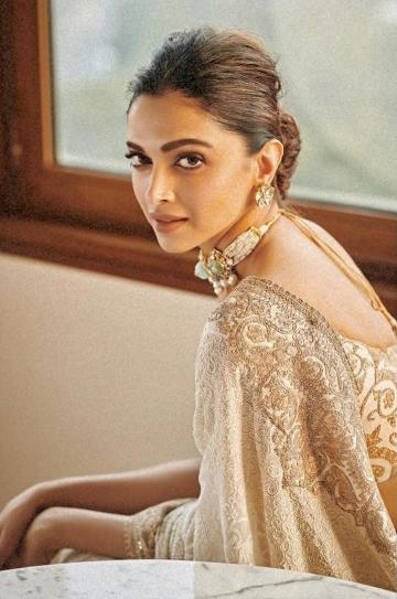 Deepika Padukone is busy being the madame, and she wasa doing it in Delhi with grace in this off-white saree from Anamika Khanna - Fashion Models