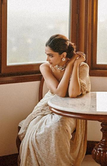 The work on the saree is exquisite and the sleeveless blouse is a nice vintage touch - Fashion Models