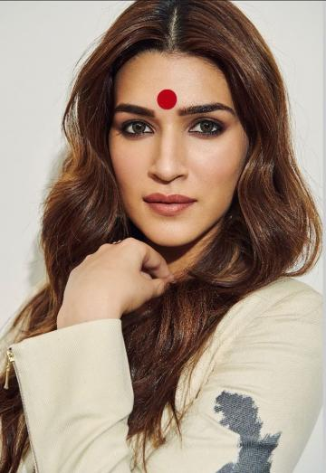 What makes, and almost overshadows this look is the huge bindi that Kriti has on - Fashion Models