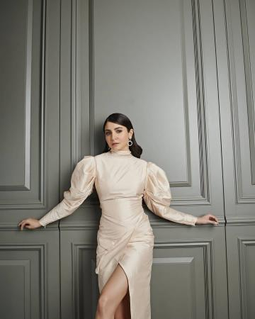 Stylist Allia Al Rufai seems to have impressed many by curating this high-necked gown which has a fabulous Leg O'Mutton sleeve and a cool cross-over hemline - Fashion Models