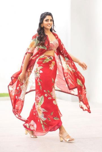 The wrap-skirt and shawl are in a red floral print and the bralette is a sequined number with floral embroidery - Fashion Models