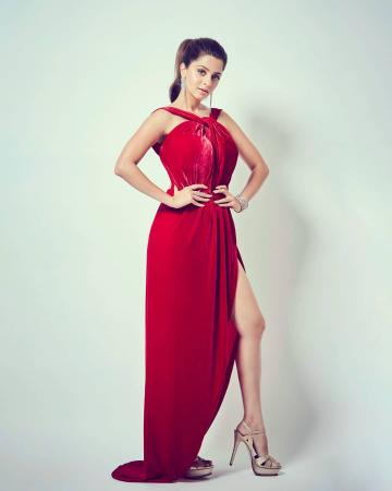 The velvet number has a tie halter neckline, a slit on the thigh and is backless - Fashion Models