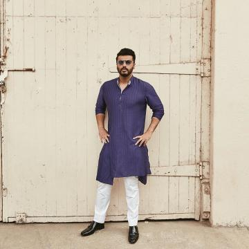 Arjun Kapoor was recently spotted in this plain but comfortable looking asymmetrical Kurta from Raghavendra Rathore - Fashion Models