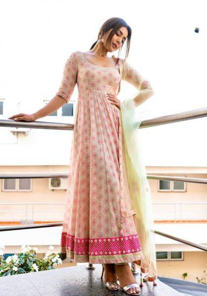 The pastel Anarkali with a bright pink border paires well with the pastel green tulle shawl - Fashion Models