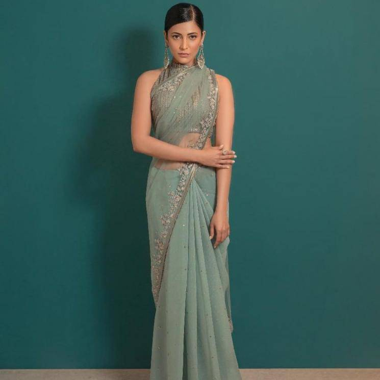 For one, we love the heavily worked sleeveless blouse and the tulle saree which has beautiful work on the border - Fashion Models