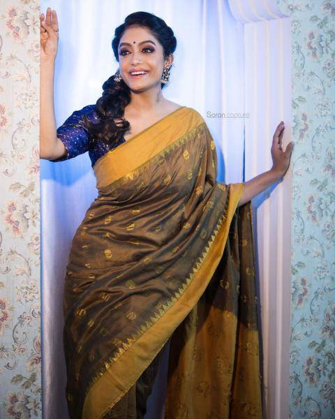 The mustard coloured saree is complemented well by the blue blouse - Fashion Models