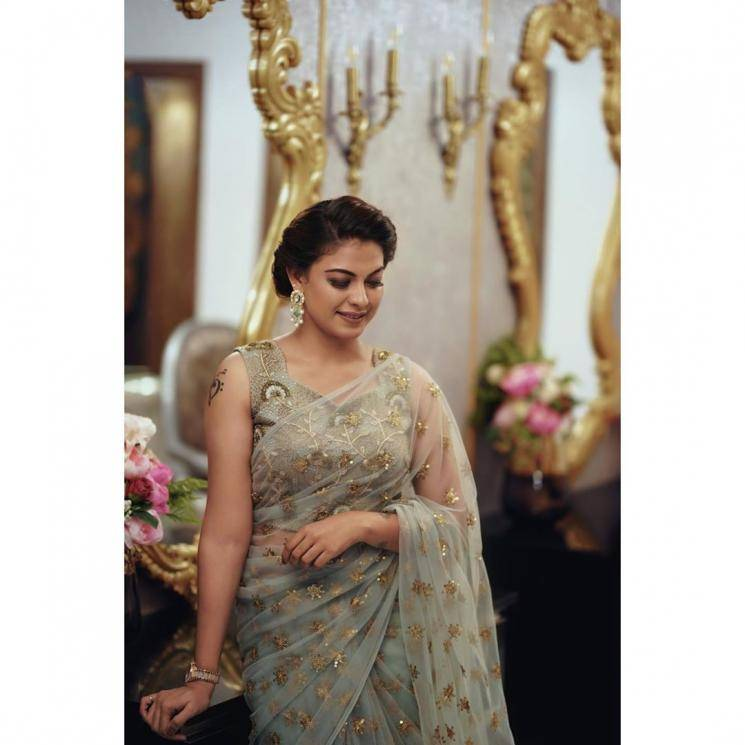 The green-grey coloured saree with golden sequins embellishments has a matching handcrafted blouse of the same work - Fashion Models