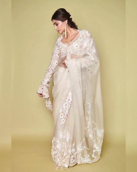 The ivory organza embroidered saree finds its character in the huge daisies on the blouse - Fashion Models