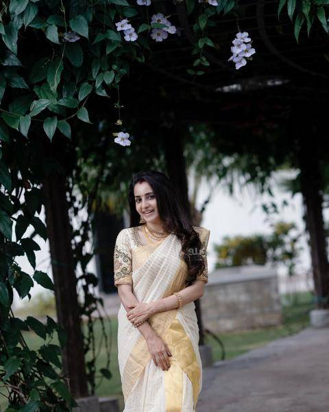 We especially love this traditional looking saree from the label, Mangalya Kasavu - Fashion Models