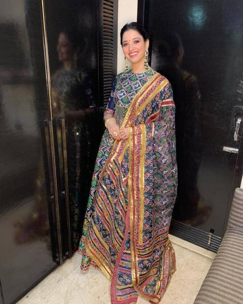 The striking kalidaar with a high neckline has gotta trimmings, Kutch mirrors, resham embroidery and multicolour chevron patterns - Fashion Models