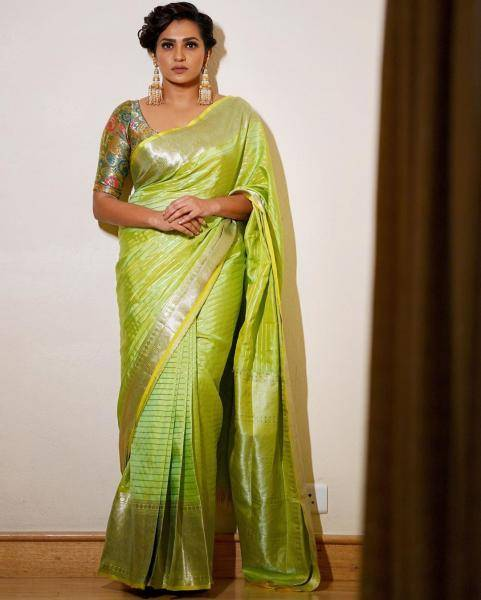 We love how Parvathy has paired the very traditional looking saree with a floral blouse; the effect is sublime - Fashion Models