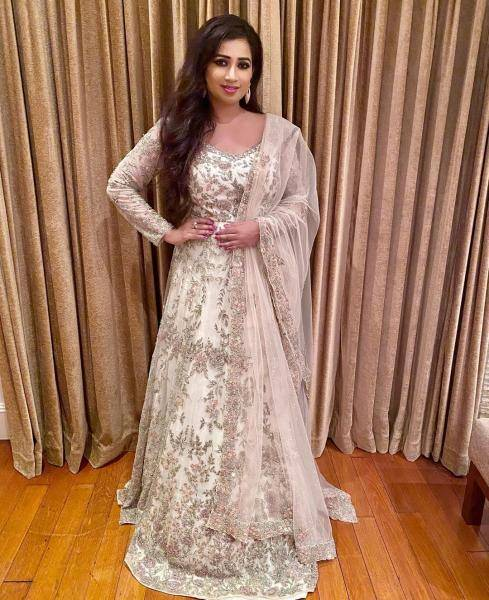 The floor-hugging anarkali from Kalighata is layered and looks good withthe tulle shawl - Fashion Models