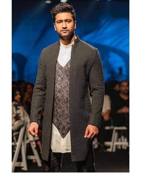 Kaushal had his thick hair gelled up and did not wear even a spot of makeup - Fashion Models