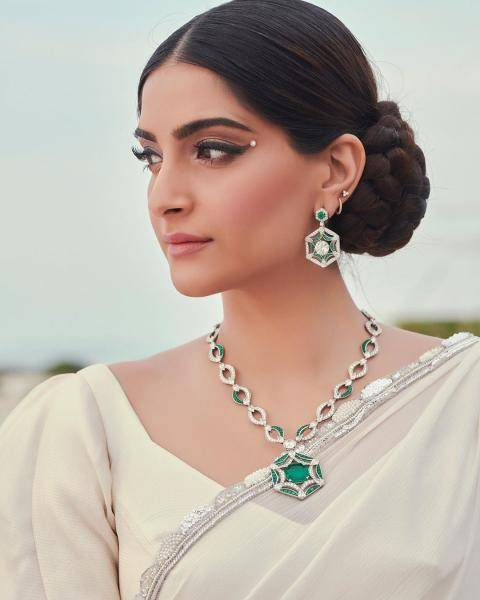 We're loving the white and green jewellery from Bulgari, which is the life of this look - Fashion Models