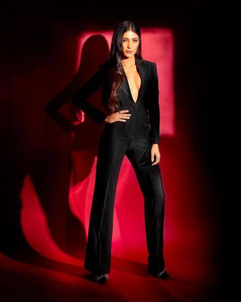 The sleek black suit has a plunging neckline and no other embellishments - Fashion Models
