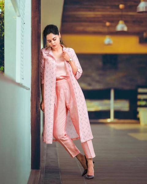 We have here a printed coat thrown over a simple pink satin tip and the ankle-length trousers  - Fashion Models