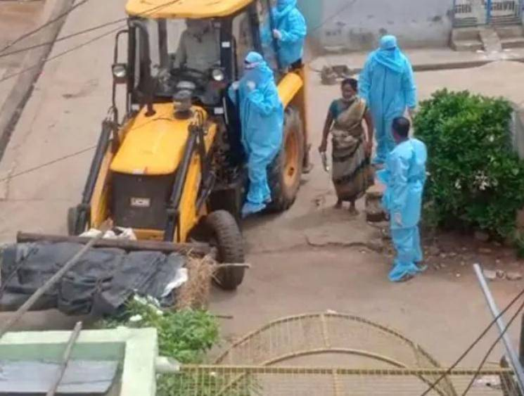 Coronavirus victim's body carried in a JCB to the crematorium in Andhra Pradesh