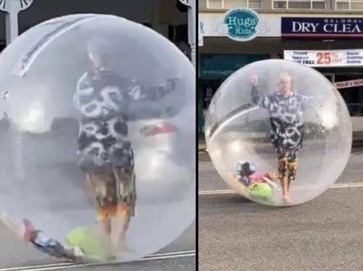 Melbourne man walks around in plastic bubble as protection against COVID-19