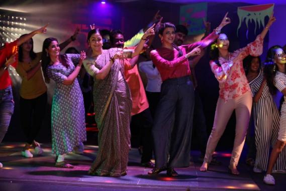 Jyothika and Lakshmi Manchu in Kaatrin Mozhi dancing to the Jimikki Kammal song