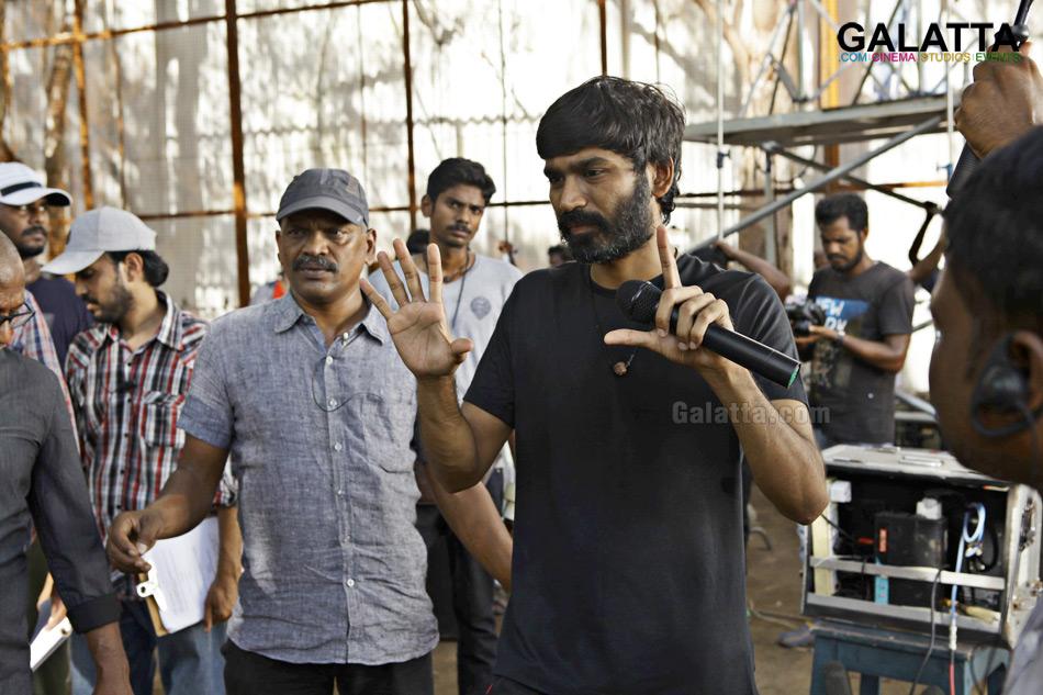Dhanush explaining a sequence to cinematographer Velraj during Pa Paandi shoot