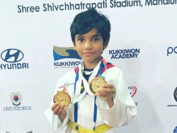 Sibiraj son Dheeran wins two gold medals at National Taekwondo Championship in Pune