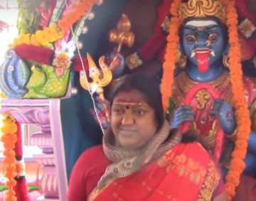 Kanchipuram godwoman surprises followers dancing with snake