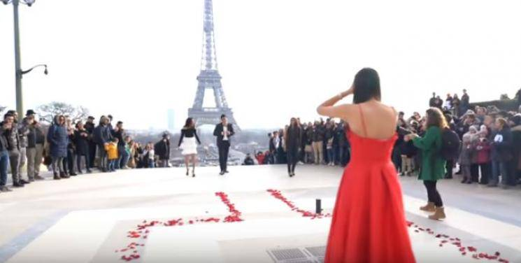 Cinema style love proposal in front of Eiffel Tower