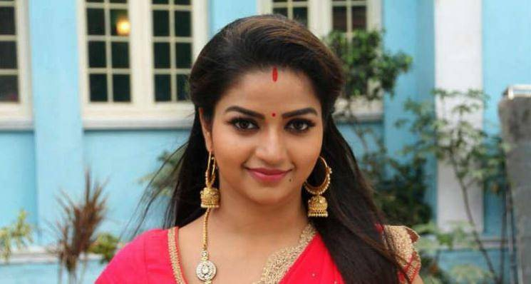 Nithya Ram romance responsibly with a corona kiss picture