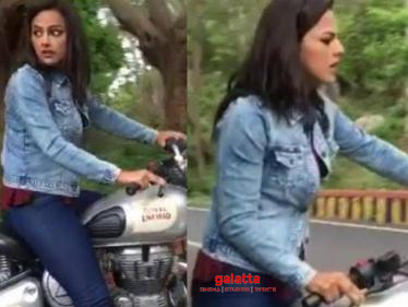 Nerkonda Paarvai actress falls from Royal Enfield bike after losing balance - Watch Video Here!