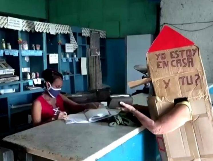 82-year-old Cuban woman wears cardboard box for protection against coronavirus